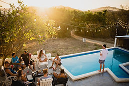 sunset backyard pool party