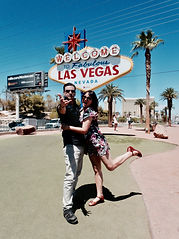 Melbourne magicians Richard Vegas and Julia Madotti in front of the iconic Vegas sign