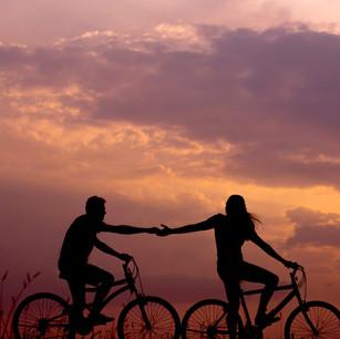 Couple enjoying a bike ride