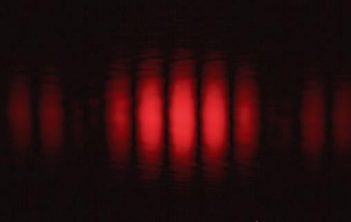 Photons through the Double-Slit Experiment