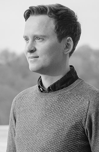 Black and white profile picture of Artistc director Jonathan Guy