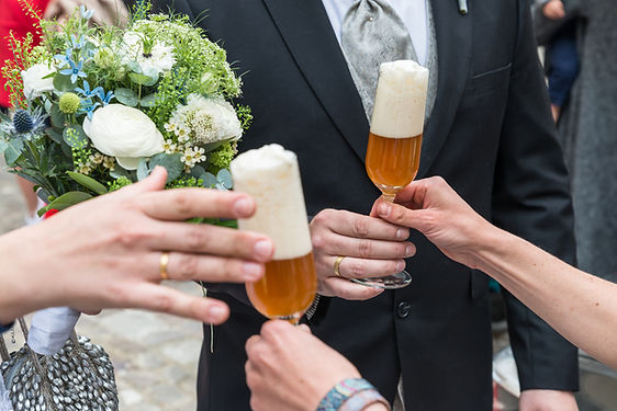 A newlywed bridal couple gets a glass of