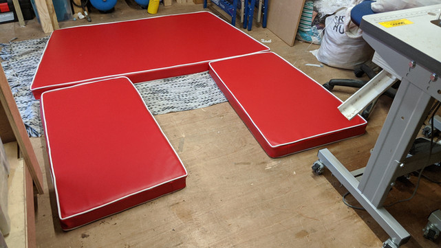 Red vinyl boat cushions with white piping