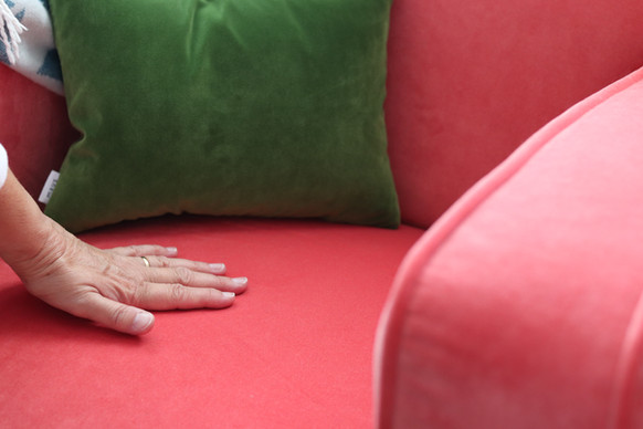 Close up of art deco armchair in flamingo velvet