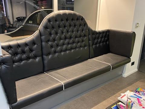 Ornate banquette sofa in salon