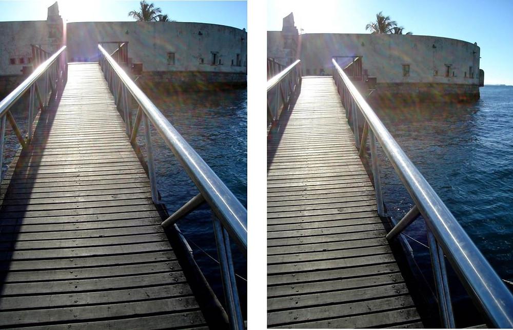 vista de trapiche de acesso a um forte cercado pelo mar