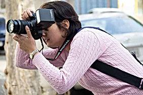 Fotografia mulher fotografando