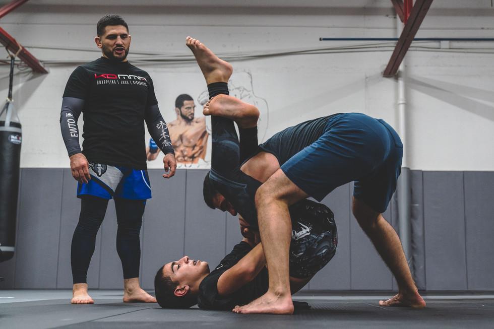Karen Darabedyan teaches a triangle choke