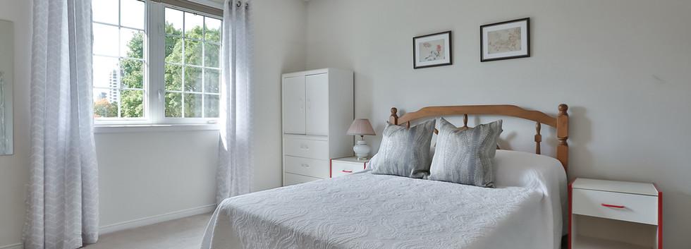 Primary bedroom with walk in closet & ensuite
