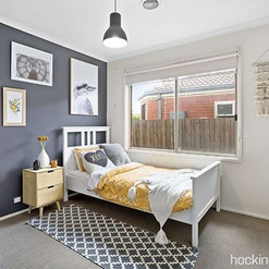 GUESTROOM   This moody yet bright bedroo