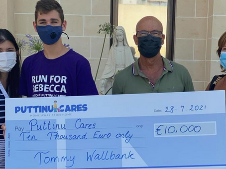 Tommy Wallbank Presents €10,000 Check To Puttinu Cares
