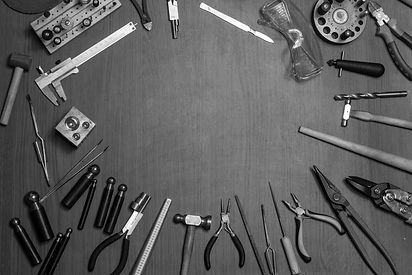 Top view of different goldsmiths tools o