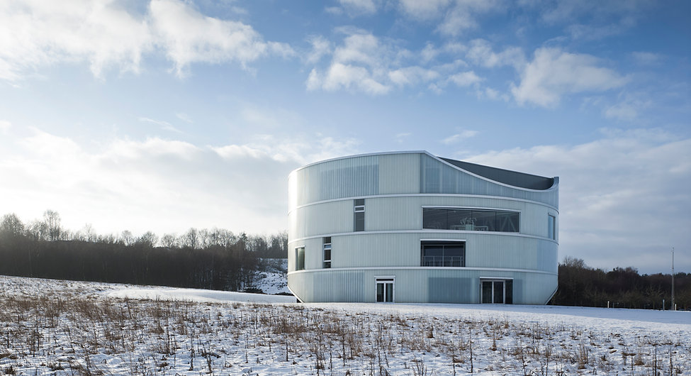 Light and snow surrounds The House of Natural Science