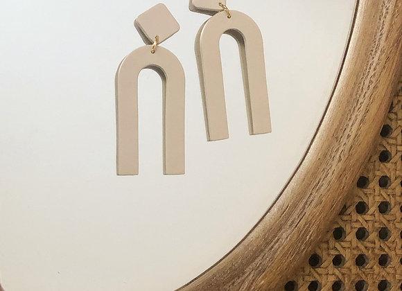 Beige long arch earrings