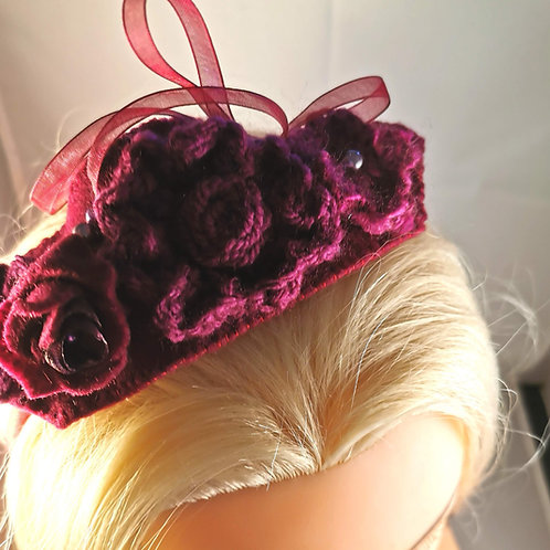 Deep burgundy headband with crocheted flowers, beads and ribbon
