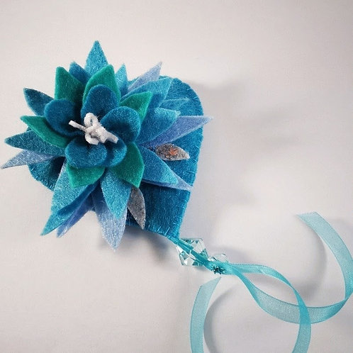 Shades of teal brooch with spiky leaves