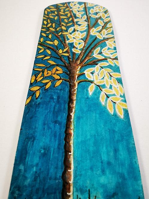 Stylised tree on blue