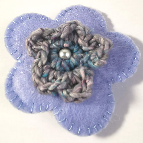Pale warm  blue felt brooch with crocheted flower and pearl