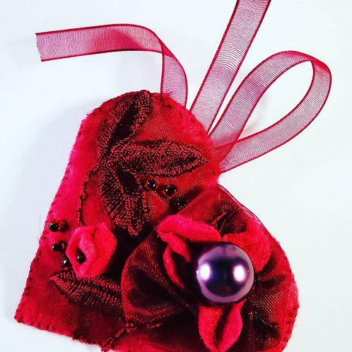 Wine red brooch