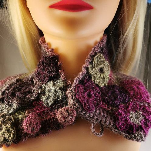 Colourful neckwarmer with crochet flower