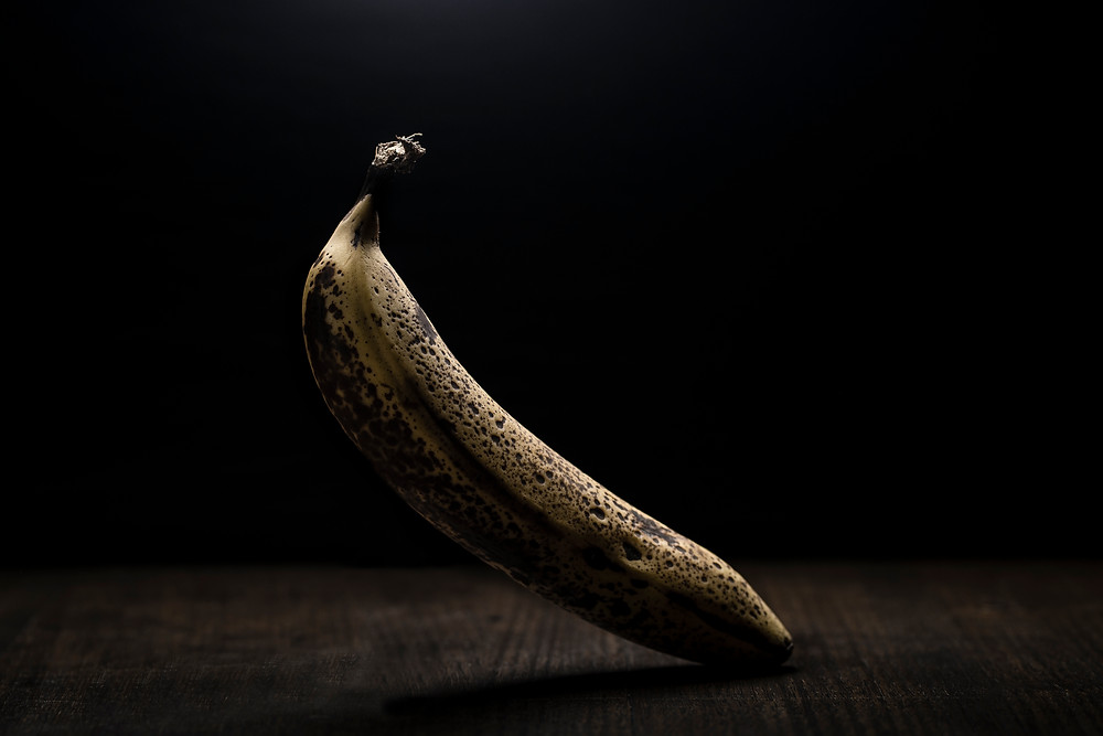 A photo of a banana in dramatic lighting