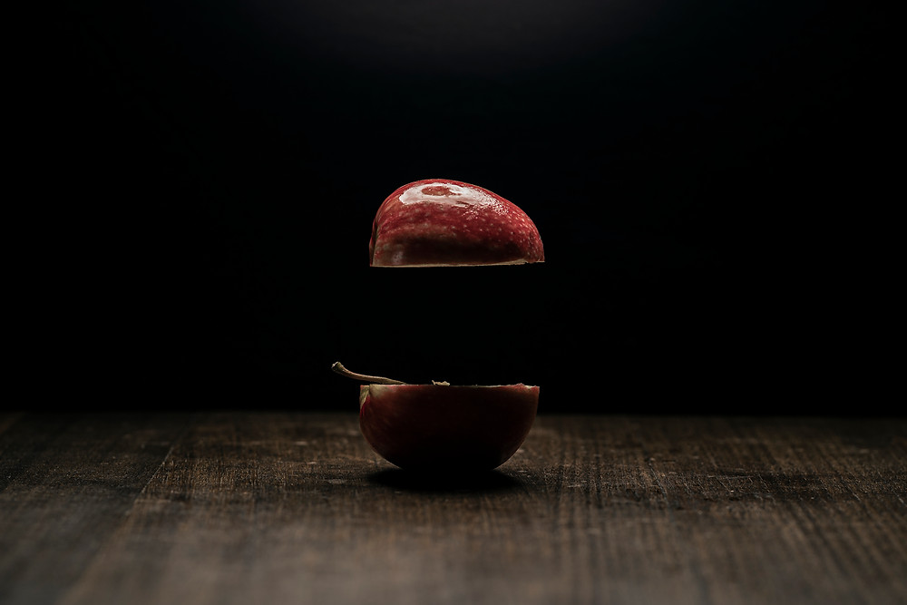 A photo of an apple split in two