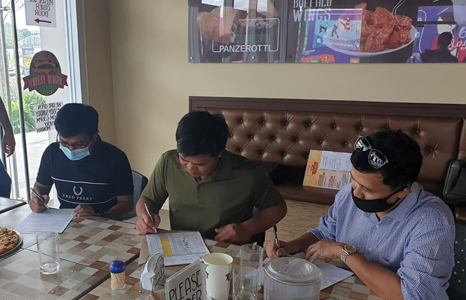 3 Filipino guys, signing documents, Ryobi Power Tools Philippines, GM Medalla, Authorized Dealer Ryobi Power Tools Philippines