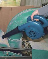 Ryobi blower removing dust