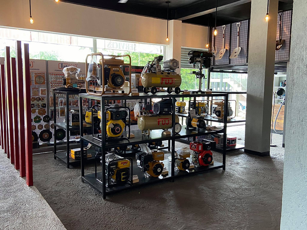 Black rack carrying various engines, pumps, generators, and batteries