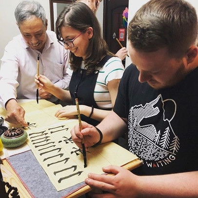 Teachers Ellie and Matt trying Calligraphy!