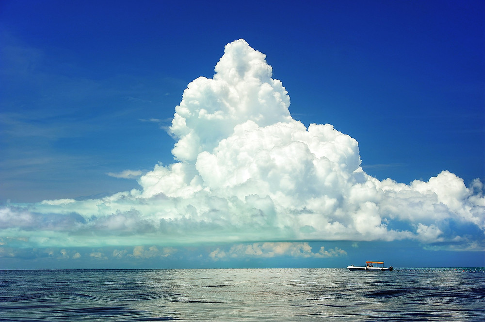 Cumulus cloud over ocean by PublicDomainPictures
