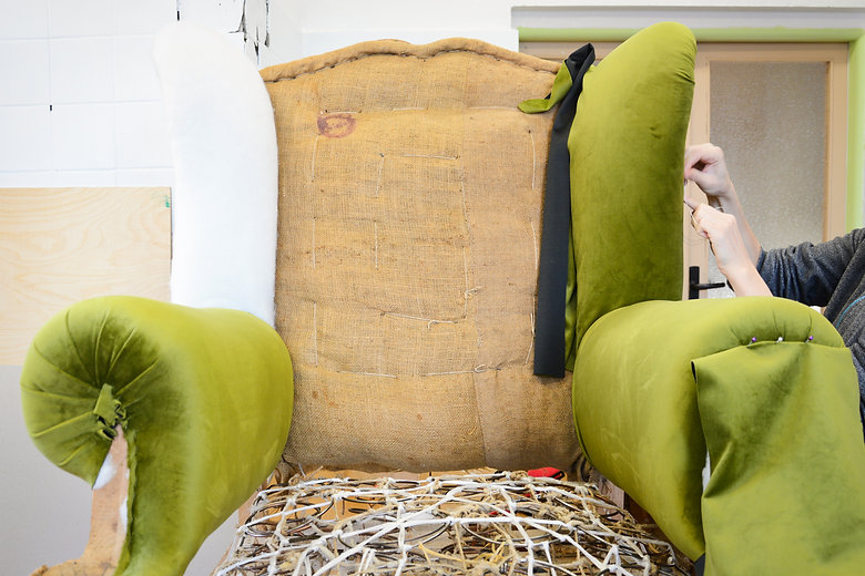 Making new upholstery on old armchair. G
