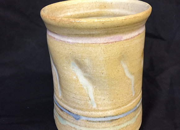 "Beige cup  5""H 3.5""W"