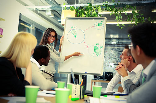 happy-businesswoman-explaining-graph-to-