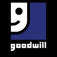 Youth landing his first job at Good Will retail store after volunteering for several months with men
