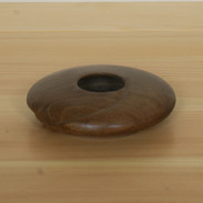 Small pebbled Black Walnut vessel with a carved spiral.