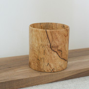 A nice piece of spalted beech thats been turned into this straight edged vessel