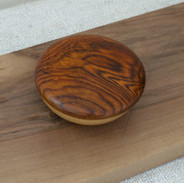 The pebble box design here is made of a light oak base with a cocobolo lid