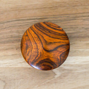 A cocobolo lid of one of the pebble boxes