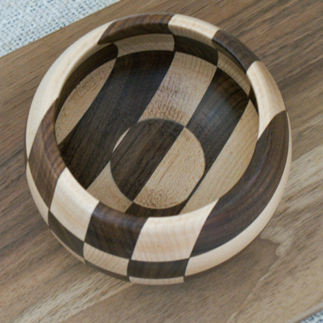 Segmented Black Walnut and Maple. Both parts were made from the remnants of a larger project