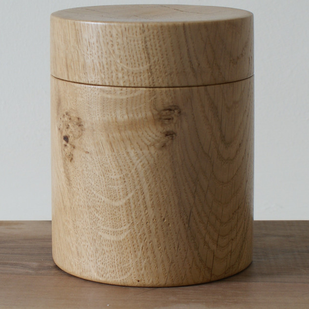 A large oak box all made from a single piece of timber.