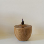 This Oak box is made of reclaimed oak and topped with a cocobolo lid handle.