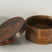 This box has a teak body and a cocobolo lid on top.