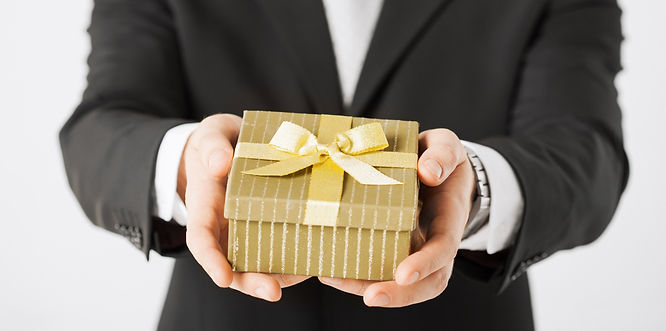 close up of man hands holding gift box._