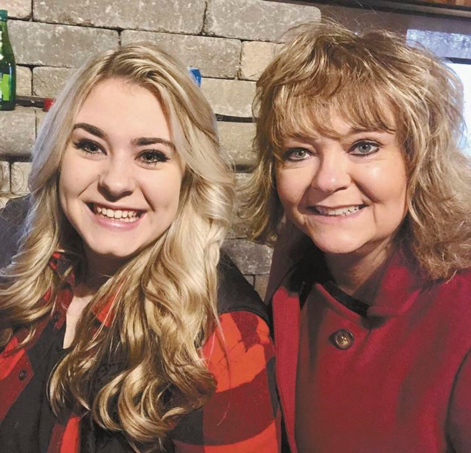 Terry, right, posing with her daughter, Sydney Terry, after being named National Educator of the Year for 2021.