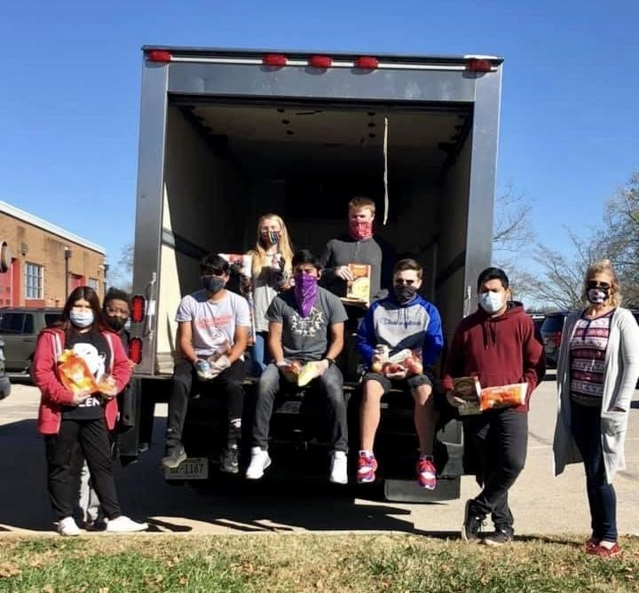 Jasmine Velasquez, Central Services Worker Kim Weaver, Jessie Ramos, Abraham Melchor, Miller Smith, Oswaldo Guzman, Director Ashley Hux, Abigail Lamb, and Andrew Goodman load the Central Services truck with food donations.