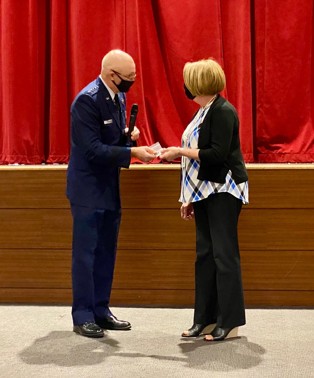 Air Force General Arnold Bunch Jr. Gives A Gift To Teacher Linda Sedlack