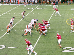East and West Line Up With West Ready to Snap The Ball