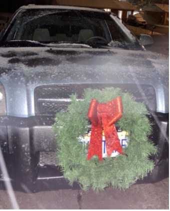 Wreath hung on the authors car