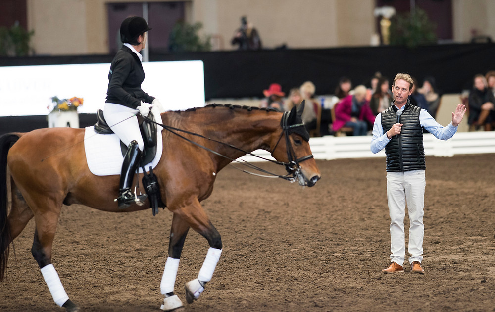 Terri Rocovich in a clinic with Carl Hester.